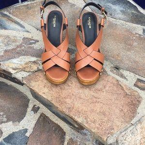 Platform sandals by Coach